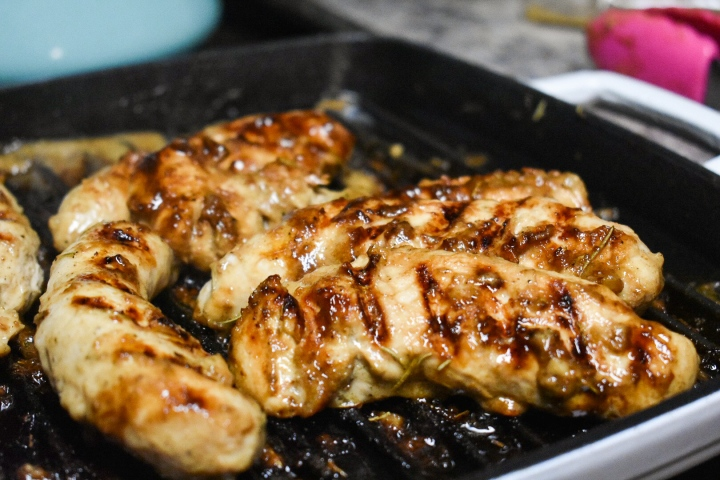 Rosemary Dijon Chicken is the easiest and best meal prepped chicken! It's perfect for wraps, on salads, or as a sheet pan dinner! www.wholesome-joy.com